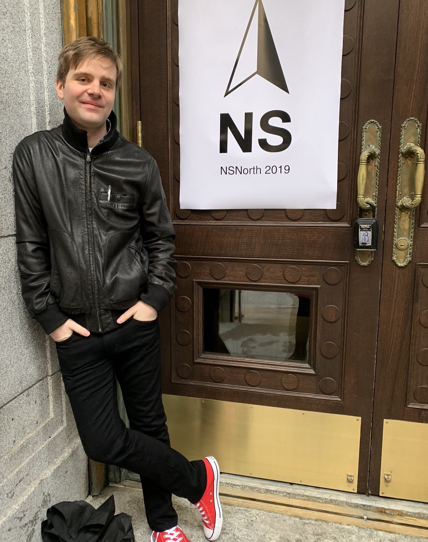 Matt outside the conference, in front of a sign that says NSNorth 2019.
