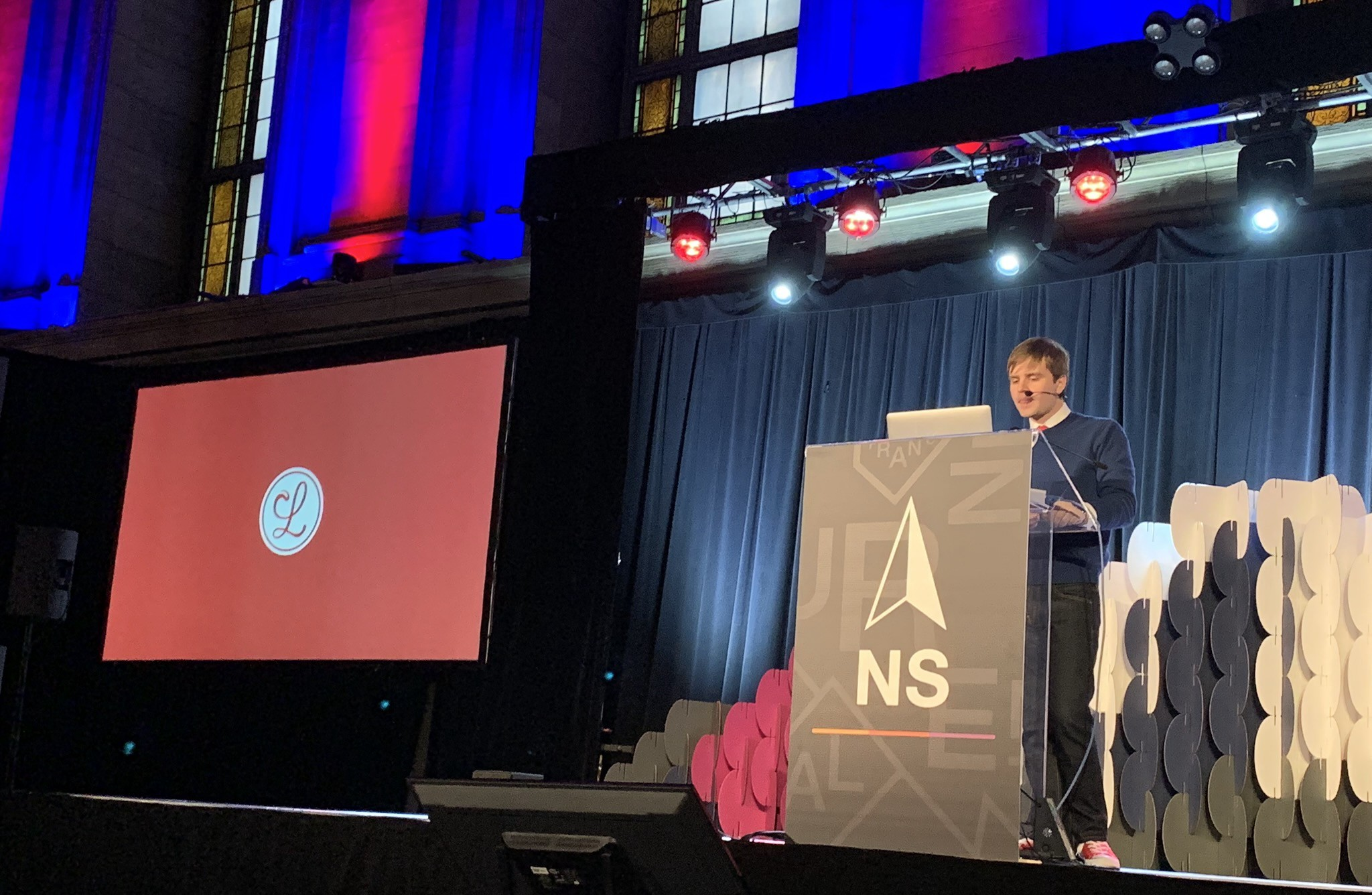 Matt onstage at NSNorth in front of a slide with the Lickability logo.
